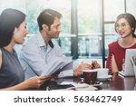 3 people meeting in coffee shop ... | Shutterstock . vector #563462749