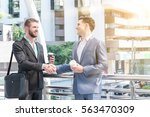 two westerner business men... | Shutterstock . vector #563470309
