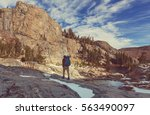 hiking man in the mountains | Shutterstock . vector #563490097