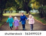 little girls running along a... | Shutterstock . vector #563499319