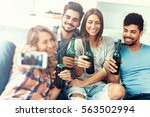 cheerful group of friends... | Shutterstock . vector #563502994