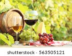 wine in glasses with bunch of... | Shutterstock . vector #563505121