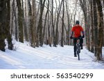 mountain biker riding bike on... | Shutterstock . vector #563540299