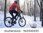 mountain biker riding bike on... | Shutterstock . vector #563540335
