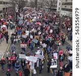 Small photo of WASHINGTON,DC - JAN 21, 2017: Women's March on Washington, looking down at arriving throng roaming side street, part of gigantic turnout that flooded DC in an anti-inauguration show of solidarity.