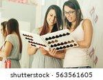 two beautiful young women... | Shutterstock . vector #563561605