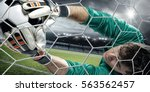 goalkeeper catches the ball  at ... | Shutterstock . vector #563562457