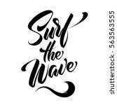 hand lettering surf the wave... | Shutterstock .eps vector #563563555