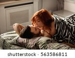 couple in love kissing in bed | Shutterstock . vector #563586811