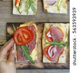 Small photo of sandwich. process of making sandwiches. Female hands make vegetarian sandwiches and meat sandwiches.