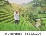 backpacker with valley rice... | Shutterstock . vector #563621209