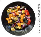 roasted vegetables on black... | Shutterstock . vector #563622994
