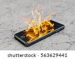 smartphone on fire. burning... | Shutterstock . vector #563629441