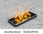 smartphone on fire. burning... | Shutterstock . vector #563629441