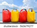 yellow and red waterproof bag... | Shutterstock . vector #563679277