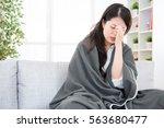 portrait of a sick woman feel... | Shutterstock . vector #563680477
