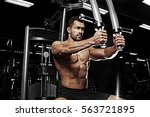bodybuilder posing in the gym | Shutterstock . vector #563721895
