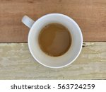 top view a cup of coffee set on ... | Shutterstock . vector #563724259