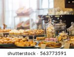 showcase with delicious sweets | Shutterstock . vector #563773591