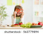 kid girl having fun with food... | Shutterstock . vector #563779894