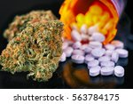 detail of cannabis buds and... | Shutterstock . vector #563784175