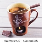hot chocolate cup with candle... | Shutterstock . vector #563803885