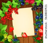 blank paper and berries on... | Shutterstock .eps vector #563803921