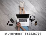 young woman sitting on floor... | Shutterstock . vector #563826799