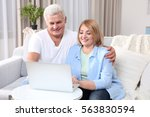 grandparents using laptop at... | Shutterstock . vector #563830594