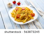 pasta tomatoes vegetables... | Shutterstock . vector #563873245