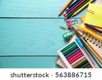 desk with stationary on wooden...   Shutterstock . vector #563886715