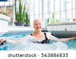 senior woman relaxing in... | Shutterstock . vector #563886835