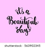 it is a beautiful day. hand... | Shutterstock .eps vector #563902345