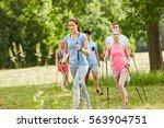 group of friends nordic walking ...   Shutterstock . vector #563904751