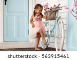 pretty small girl in beautiful... | Shutterstock . vector #563915461