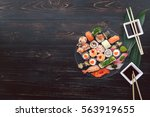 sushi on a black wooden surface   Shutterstock . vector #563919655