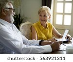 senior couple daily lifestyle... | Shutterstock . vector #563921311