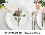 flower arrangement on table... | Shutterstock . vector #563933431