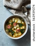sausage kale and potato soup... | Shutterstock . vector #563939374