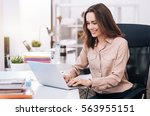 smiling young businesswoman... | Shutterstock . vector #563955151