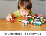 young boy is playing with many... | Shutterstock . vector #563959471