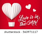 white folded paper heart shape... | Shutterstock .eps vector #563971117