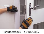 handyman repair the door lock... | Shutterstock . vector #564000817