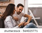 young happy couple sitting on... | Shutterstock . vector #564025771