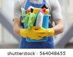 young man holding bucket with... | Shutterstock . vector #564048655