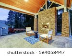 Chic Covered Back Patio With...