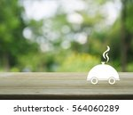 Restaurant cloche flat icon on wooden table over blur green tree background, Food delivery concept