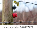 red and black electric fence... | Shutterstock . vector #564067429