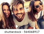 group of happy young friends... | Shutterstock . vector #564068917