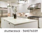 gourmet kitchen features white... | Shutterstock . vector #564076339